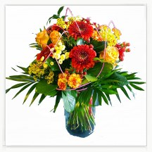 A bouquet of roses, gerberas, carnations and green additions